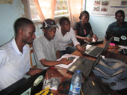 Trainees in Cameroon learning how to upload their GPS data to create maps.