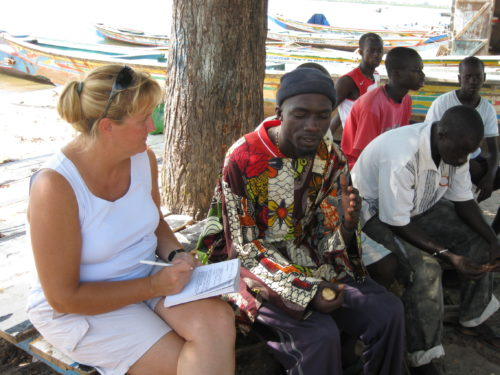 Dr. Keith Diagne (left) interviews fishermen in Senegal to understand where manatees are seen. Local knowledge is an important starting point for determining manatee habitat preferences.